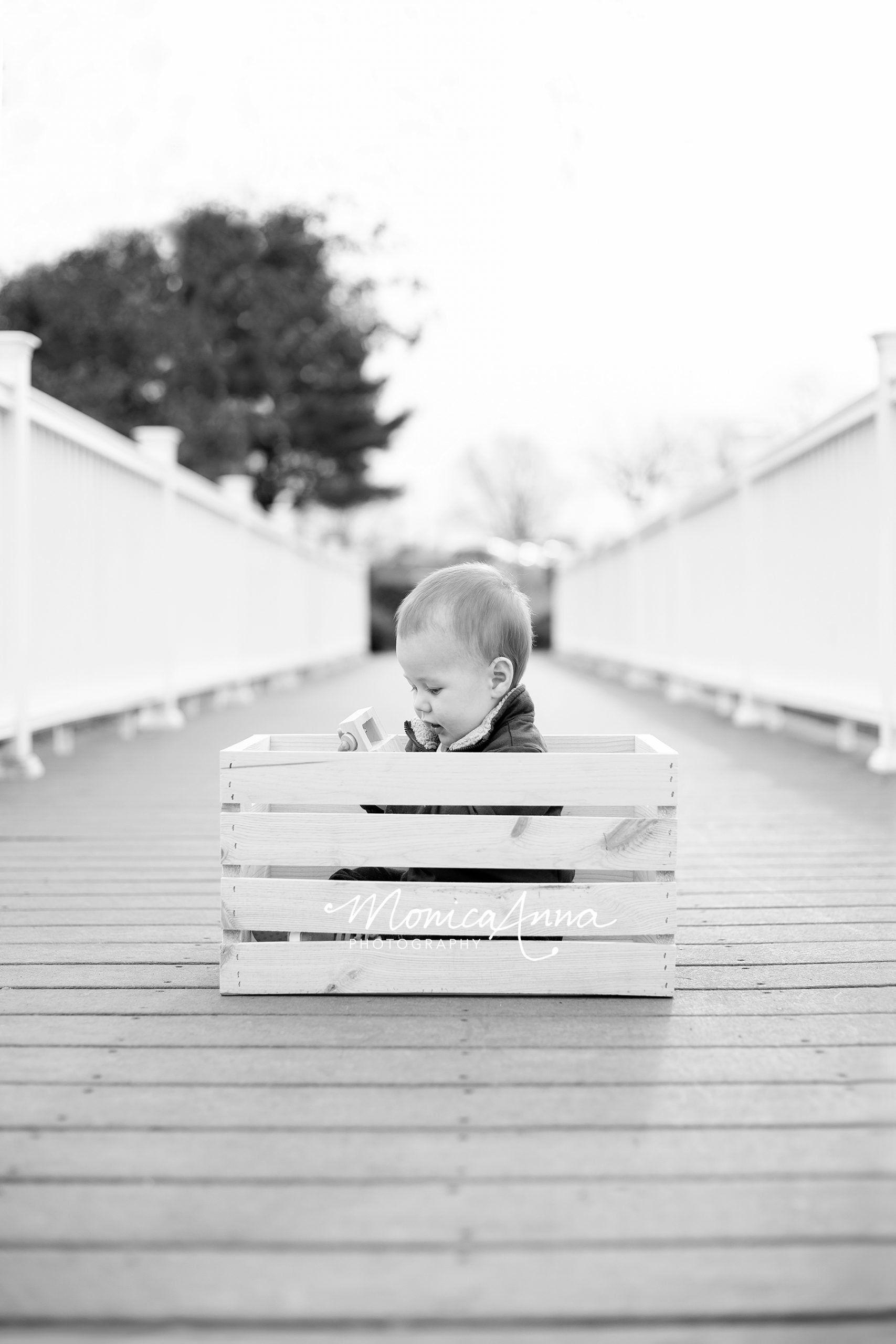 NJ Family Photographer Baby boy in wooden crate BW